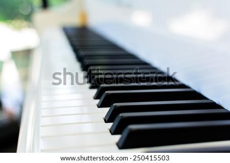 Close up of piano key on white piano