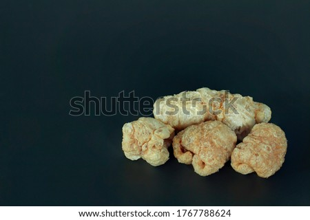 Photo of Close-up of pictures of pork caps on a black background.There is a copy space for text as a snack to enjoy in free time.Popular is food in Asia.