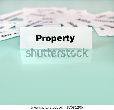 Close up of piece of paper with word or sign property