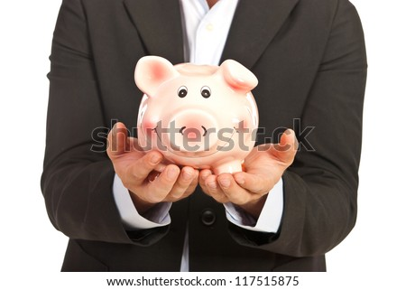 Close up of piggy bank in business man hands isolated on white background