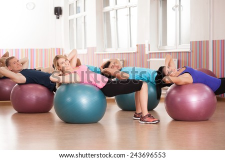 Close-up of pilates exercise with fitness balls