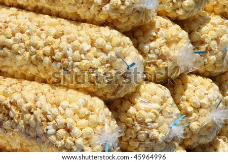 close-up of pile of large plastic bags of bright yellow popcorn