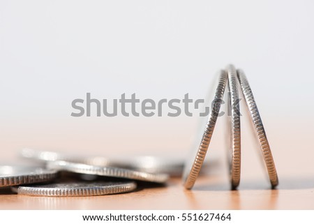 Close up of pile of silver  coins over soft background with copy space for finance business and banking concept #551627464
