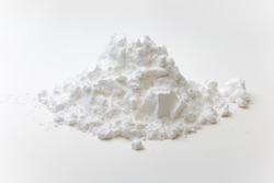 Close-up of pile of tapioca starch or flour powder on white background