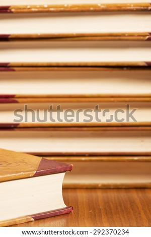 Close-up of pile with old vintage books. Hardcover leather literature.