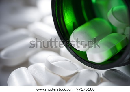 close up of pills in a bottle