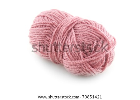 Close up of pink knitting wool on white background.