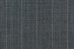 Close up of pinstriped fabric texture for garment manufacturing in grey color. Wool textile for suiting.