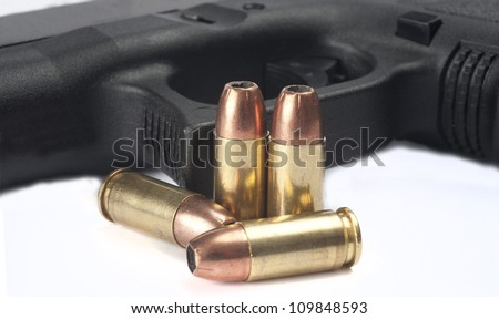 Close up of pistol and ammuntion on white background