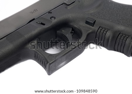 Close up of pistol on white background