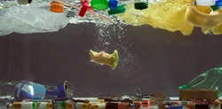 Close up of plastic bags, batteries, food waste and other types of garbage in the dark water. Ecological disaster and pollution of the world ocean concept. Web Banner
