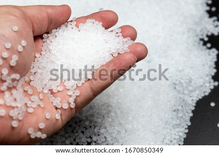 Close-up of plastic polymer granules. polymer plastic. compound polymer.plastic beads Stockfoto ©