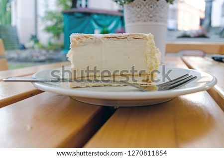 Close-up of Polish Papal Cream Cake in plate on table.  #1270811854