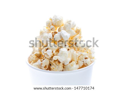Close up of pop corn in white paper cup