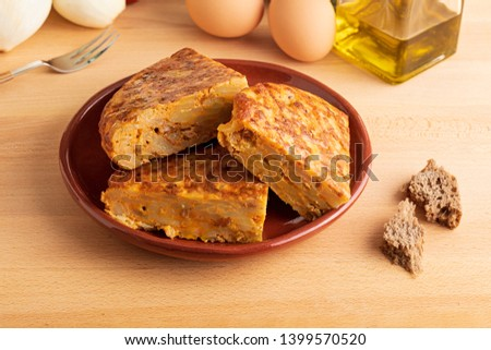 Close-up of portions of homemade (Spanish) potato omelette with natural ingredients (fresh eggs, olive oil, potatoes, onion, chorizo)
