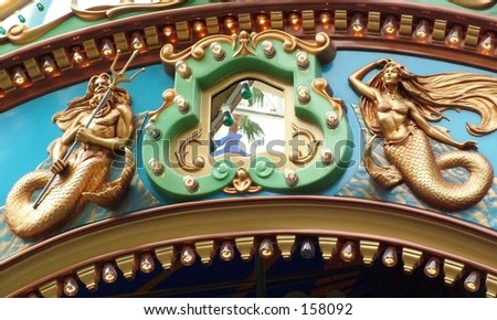 Close up of Poseidon and Mermaid figure on carousel