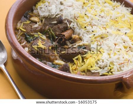 Close up of Pot of Lamb Biryani with a spoon
