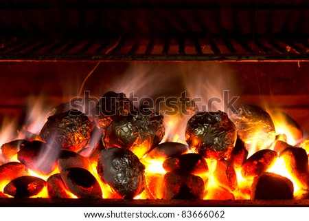 Close up of potatoes cooked on barbecue