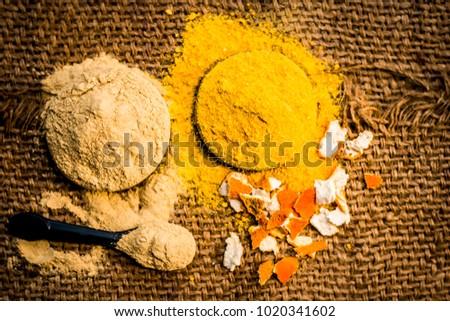 Close up of powder of fuller's earth,mulapni mitti or multani mitti and powder  of dried peel of orange.;