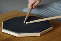 close up of practicing on a drum pad