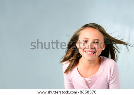 close-up of pretty blonde girl child smiling