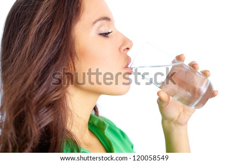 Close-up of pretty girl drinking water from glass #120058549