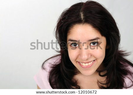 close up of pretty young latina girl smiling