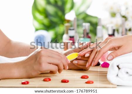 Close up of process of manicure at beauty salon