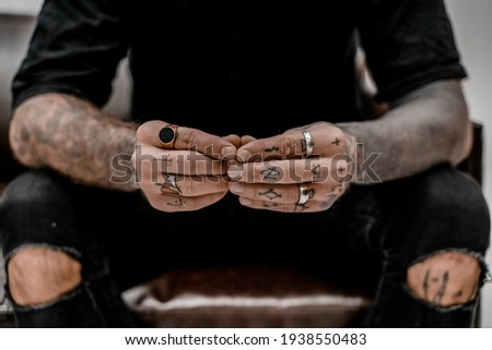 Close up of professional tattooer artist. Tattoo art on body. Equipment for making tattoo art. Master makes tattooed in studio.