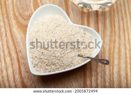 Close up of psyllium husk (ispagula) in a spoon. Psyllium husk, also called isabgol, is a fiber obtained from the seeds of the plantain ovate plant found in India. Selective focus.  Stock photo ©