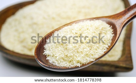 Close up of psyllium (ispaghula) husk in wooden spoon.Psyllium husk also called isabgol is fiber derived from the seeds of Plantago ovata plant found in India. Selective focus. Stock photo ©