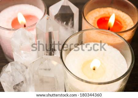 Close up of quartz crystals aligned and lighted color candles