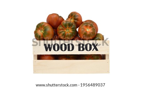 Close up of Raf Tomatoes in wood crate on white background Zdjęcia stock ©