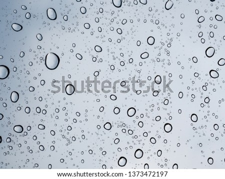 close up of rain drops or water drop on glass #1373472197