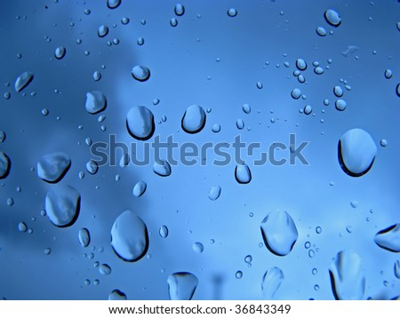 close up of raindrops on glass window