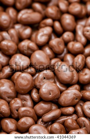 Close up of raisins covered in delicious chocolate