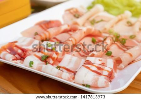 Close up of raw food raw materials, raw pork, thin slides