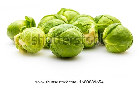 Close-up of raw, fresh and whole brussels sprouts (cabbages - Brassica oleracea). Isolated on white background. Stockfoto ©