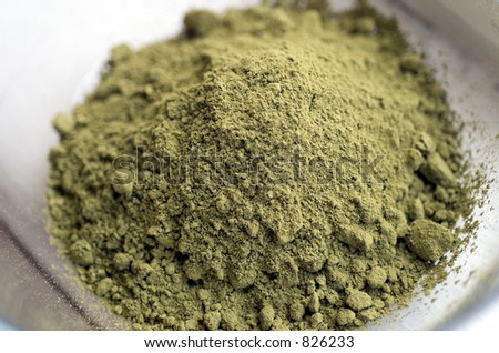 Close up of raw Henna powder used for natural color dyeing