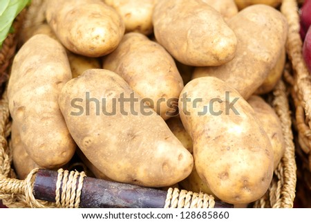Close-up of raw potatoes for sale at the market. Horizontal Shot.