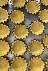 Close up of raw tartlets in baking dish before baking,