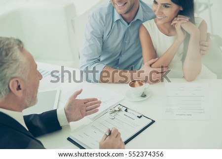 Close up of real estate agent giving consultation to family couple #552374356