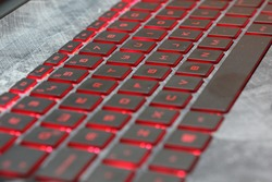 Close-up of red backlit keyboard with gray on hp laptop star wars edition