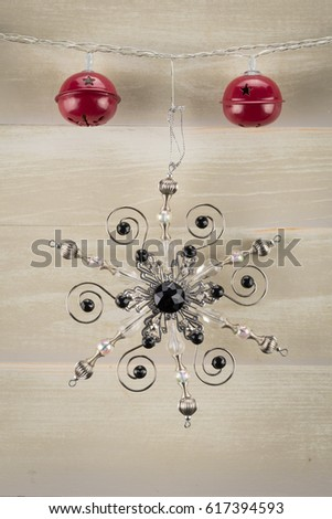 Close up of Red Bells and Snowflake on neutral background #617394593