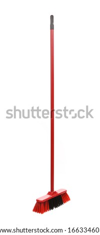 Close up of red black broom. Isolated on a white background.