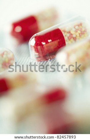 Close-up of red capsules - selective focus
