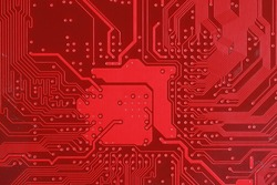 Close-up of red electronic motherboard circuit with processor
