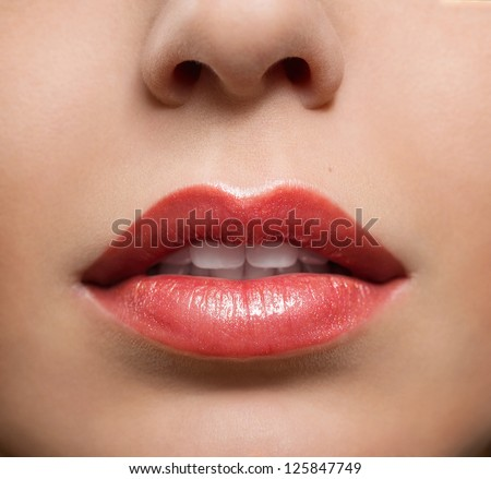 Close up of red glossy female lips