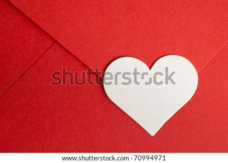 close-up of red paper envelope with white heart
