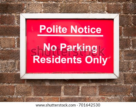 close up of red placard sign outside houses no parking residents only; England; UK #701642530